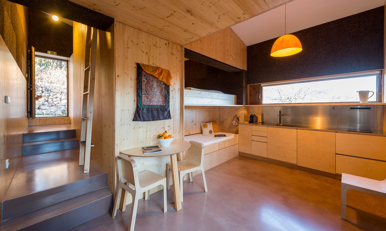 Kitchen, Metal Counter, Open Cabinet, Wood Cabinet, Pendant Lighting, Ceiling Lighting, Drop In Sink, and Metal Backsplashe  Photo 14 of 16 in Stay in a Tiny, Eco-Friendly House in a Portuguese Schist Village