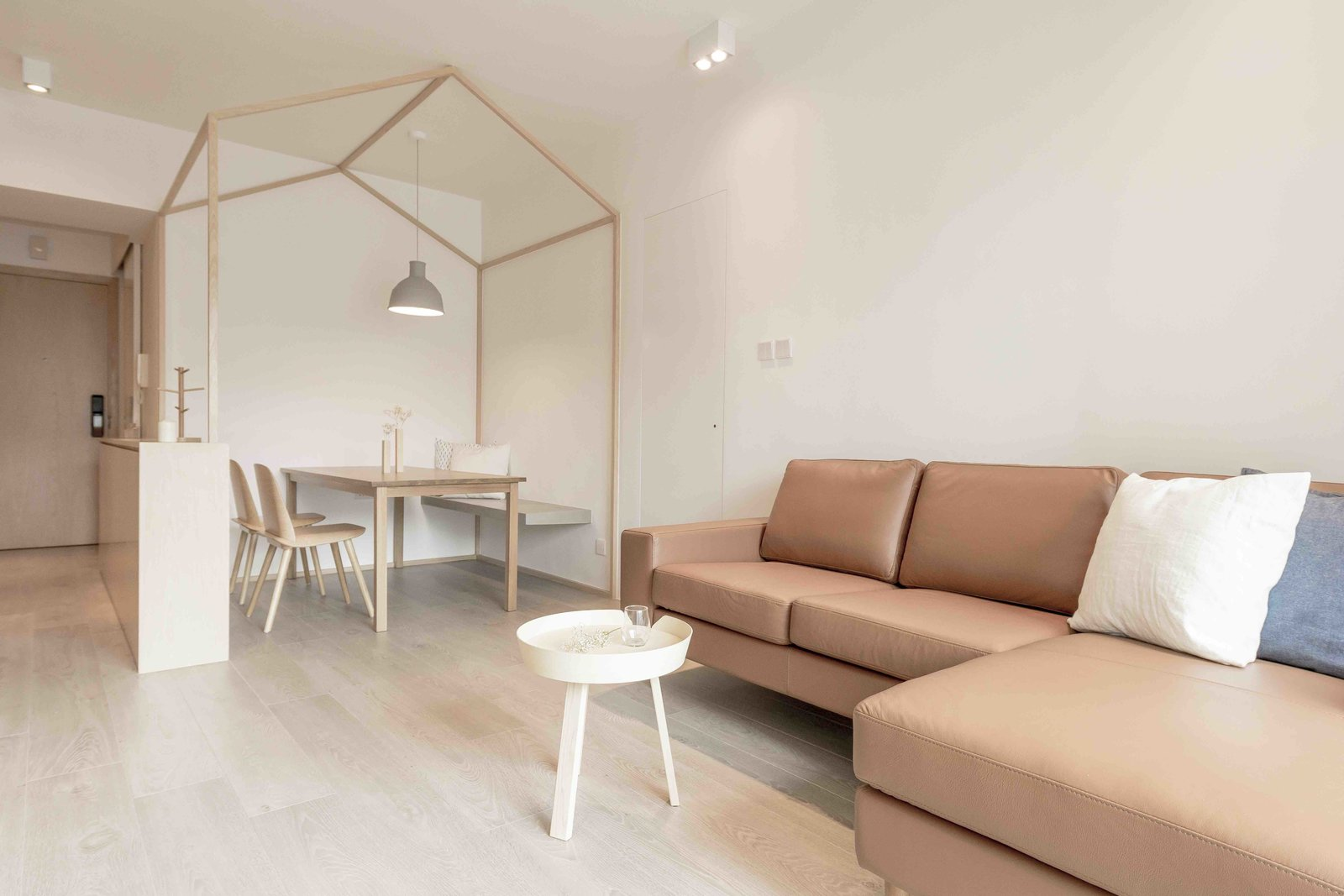 Sofa, Sectional, End Tables, Dining, Ceiling, Light Hardwood, Chair, Bench, Pendant, and Table  Dining End Tables Bench Photos from An Origami-Inspired Apartment in Hong Kong With Tons of Smart Storage