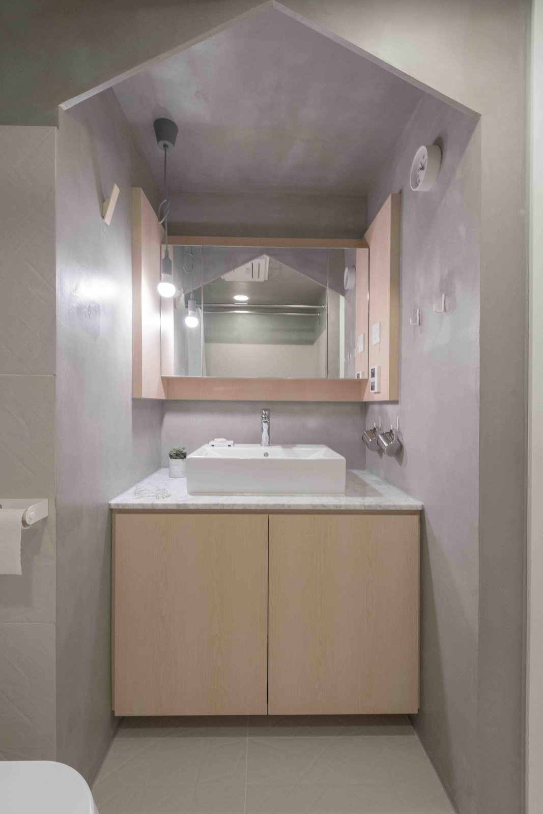 Bath Room, Vessel Sink, Marble Counter, and Ceiling Lighting  Photo 8 of 15 in An Origami-Inspired Apartment in Hong Kong With Tons of Smart Storage