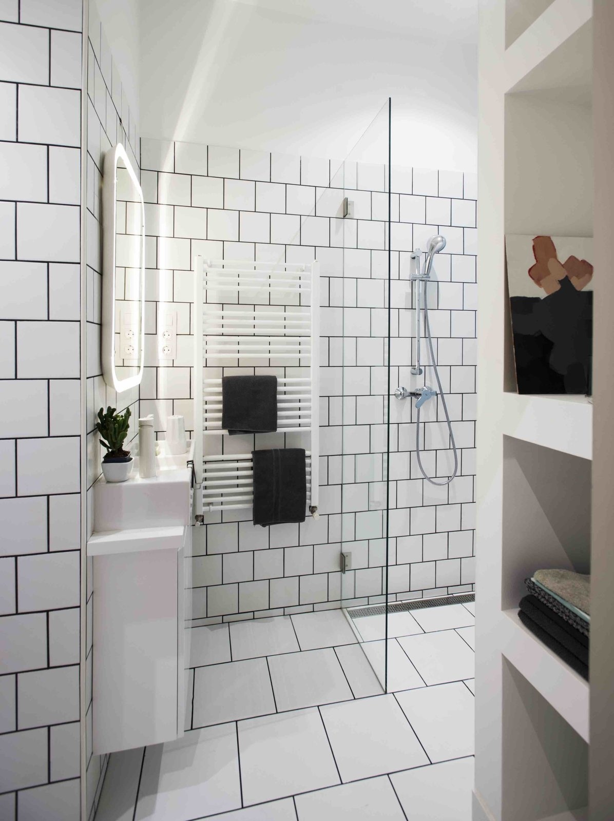 Bath Room, Open Shower, and Wall Lighting  Photo 5 of 11 in 3 Smart Storage Systems Maximize Space in a Tiny Studio Apartment in Budapest