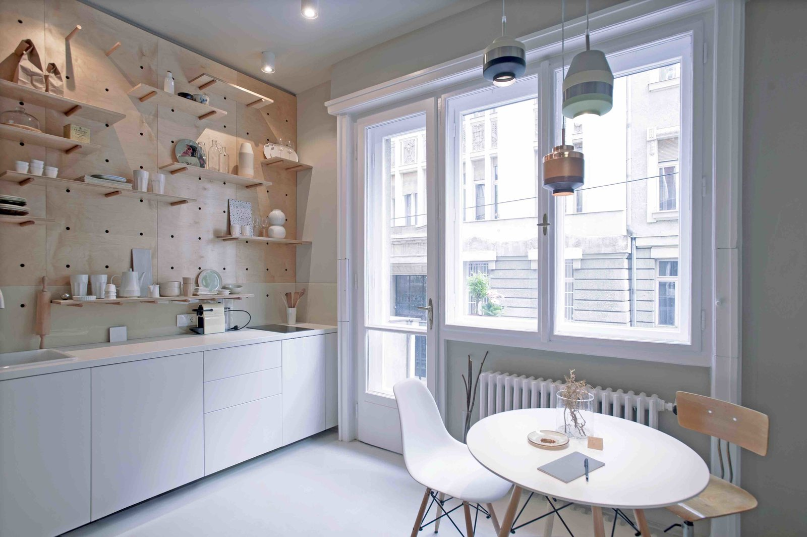 Kitchen, White, Wood, Pendant, Ceiling, Drop In, and Cooktops  Best Kitchen Wood Ceiling Photos from 3 Smart Storage Systems Maximize Space in a Tiny Studio Apartment in Budapest
