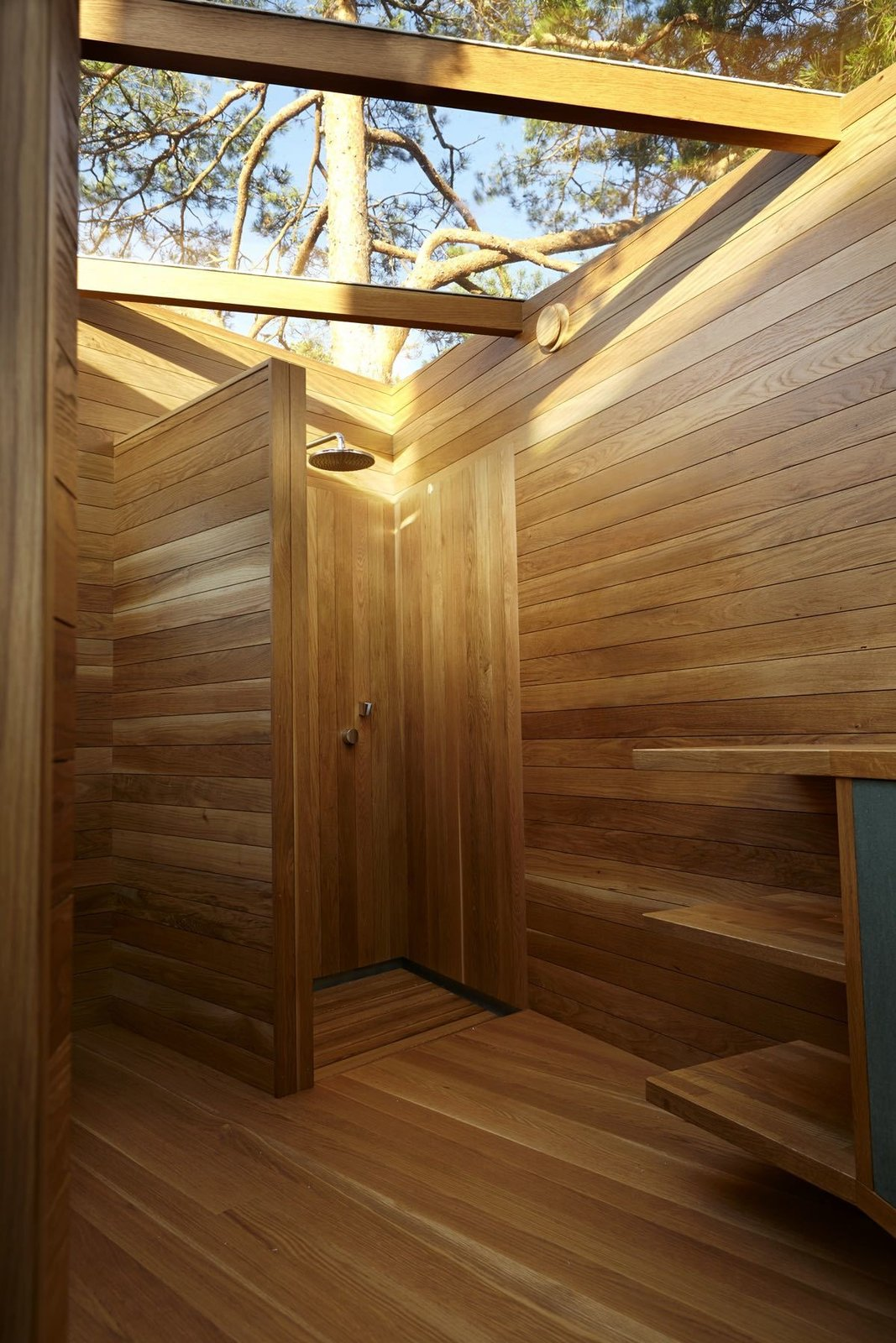 Outdoor, Shower Pools, Tubs, Shower, and Wood Fences, Wall  Photo 5 of 10 in A Tiny Bathhouse on the Norwegian Island of Hankø Made With Sustainable Softwood