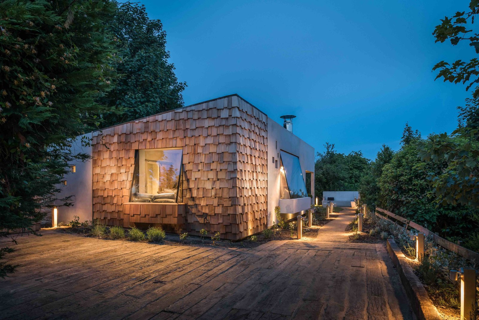 Exterior, Cabin Building Type, House Building Type, Shingles Roof Material, and Wood Siding Material  Photo 1 of 13 in Hide Out in a Tiny Concrete-and-Shingle Cottage For Rent in Cornwall