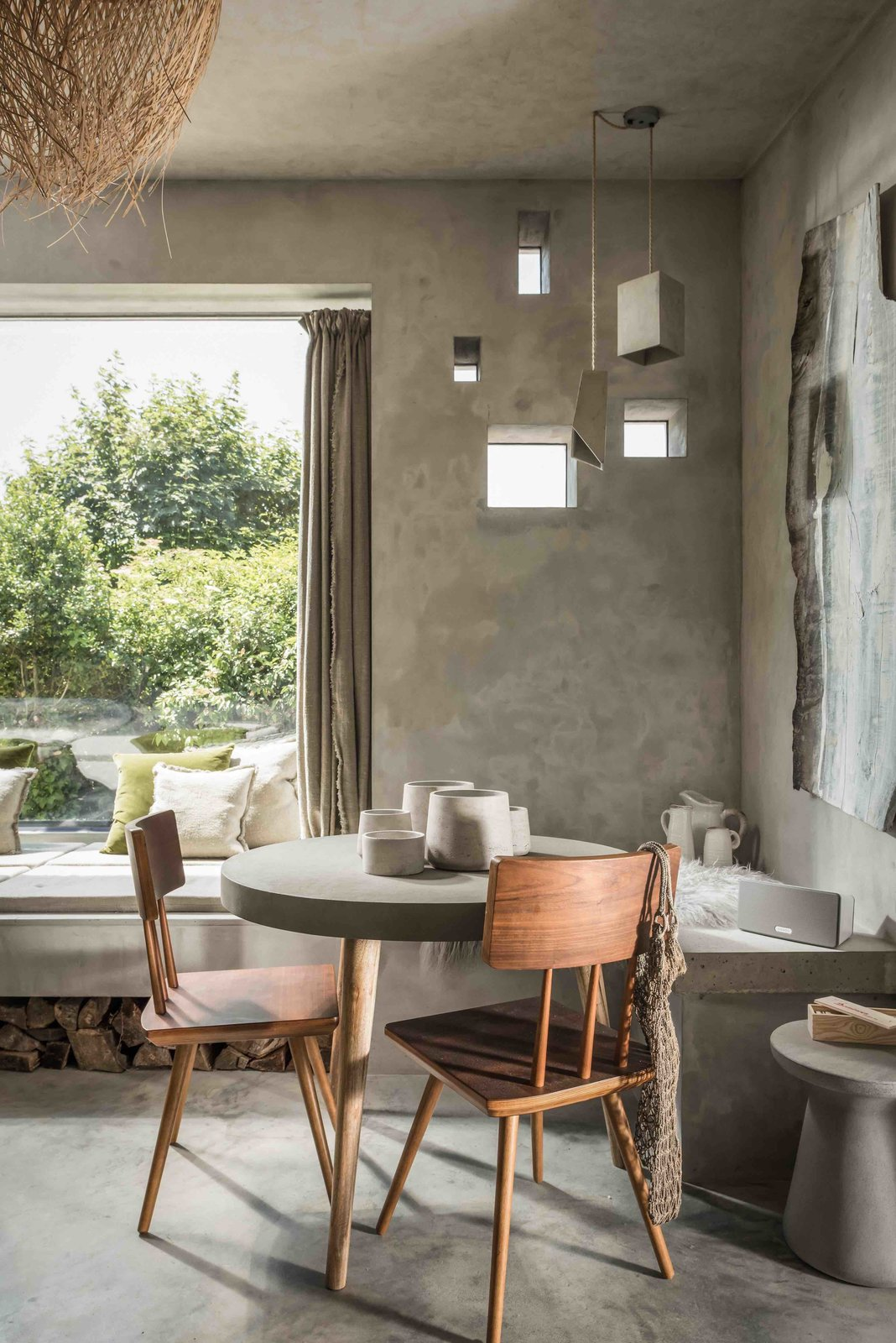 Dining Room, Table, Chair, Bench, Stools, Pendant Lighting, and Concrete Floor  Photo 6 of 13 in Hide Out in a Tiny Concrete-and-Shingle Cottage For Rent in Cornwall