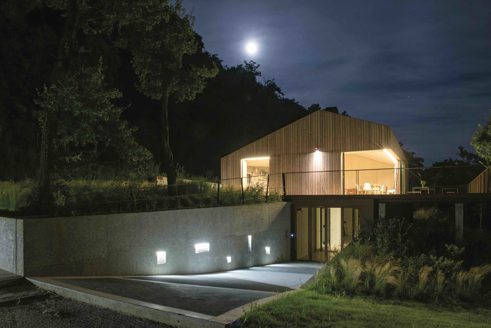 Outdoor, Front Yard, Shrubs, Grass, Walkways, Metal Fences, Wall, and Trees  Photo 6 of 14 in This Eco-Friendly Bed-and-Breakfast in Italy Is the Perfect Indoor/Outdoor Escape