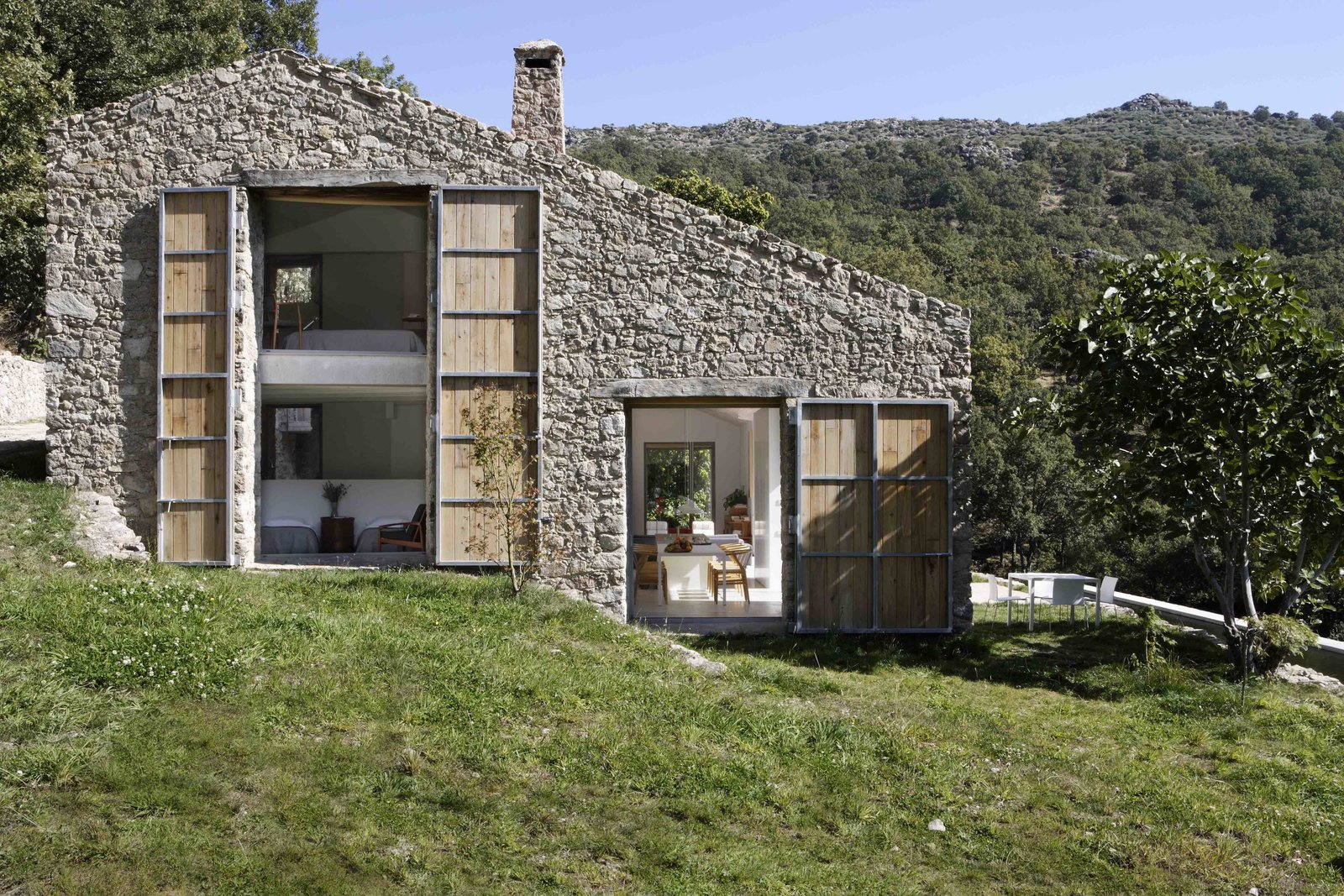 Exterior, House, Stone, Wood, and Farmhouse  Best Exterior Wood Farmhouse House Photos from An Abandoned Stable in Spain Is Transformed Into a Sustainable Vacation Home For Rent