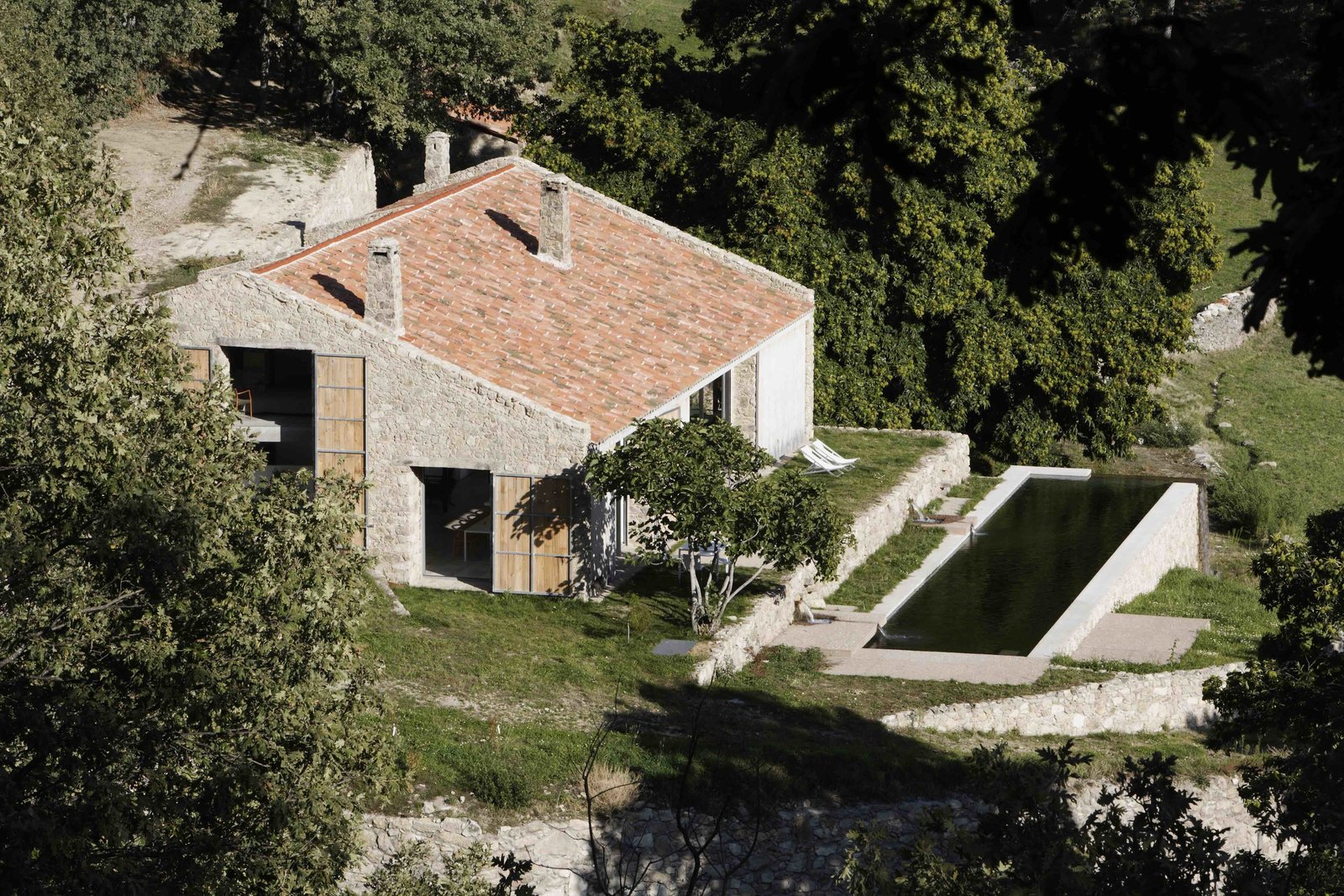 Exterior, Barn Building Type, Tile Roof Material, Wood Siding Material, Stone Siding Material, House Building Type, and Farmhouse Building Type  Photo 10 of 14 in An Abandoned Stable in Spain Is Transformed Into a Sustainable Vacation Home For Rent