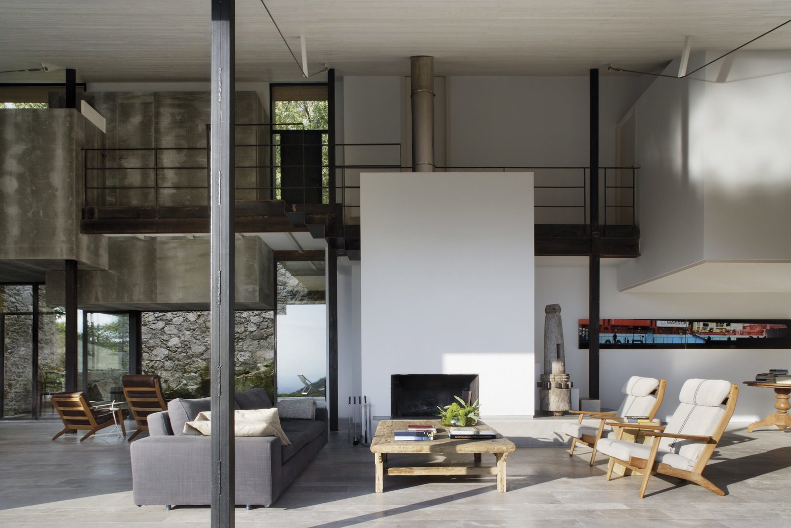 Living Room, Chair, Sofa, and Standard Layout Fireplace  Photo 3 of 14 in An Abandoned Stable in Spain Is Transformed Into a Sustainable Vacation Home For Rent