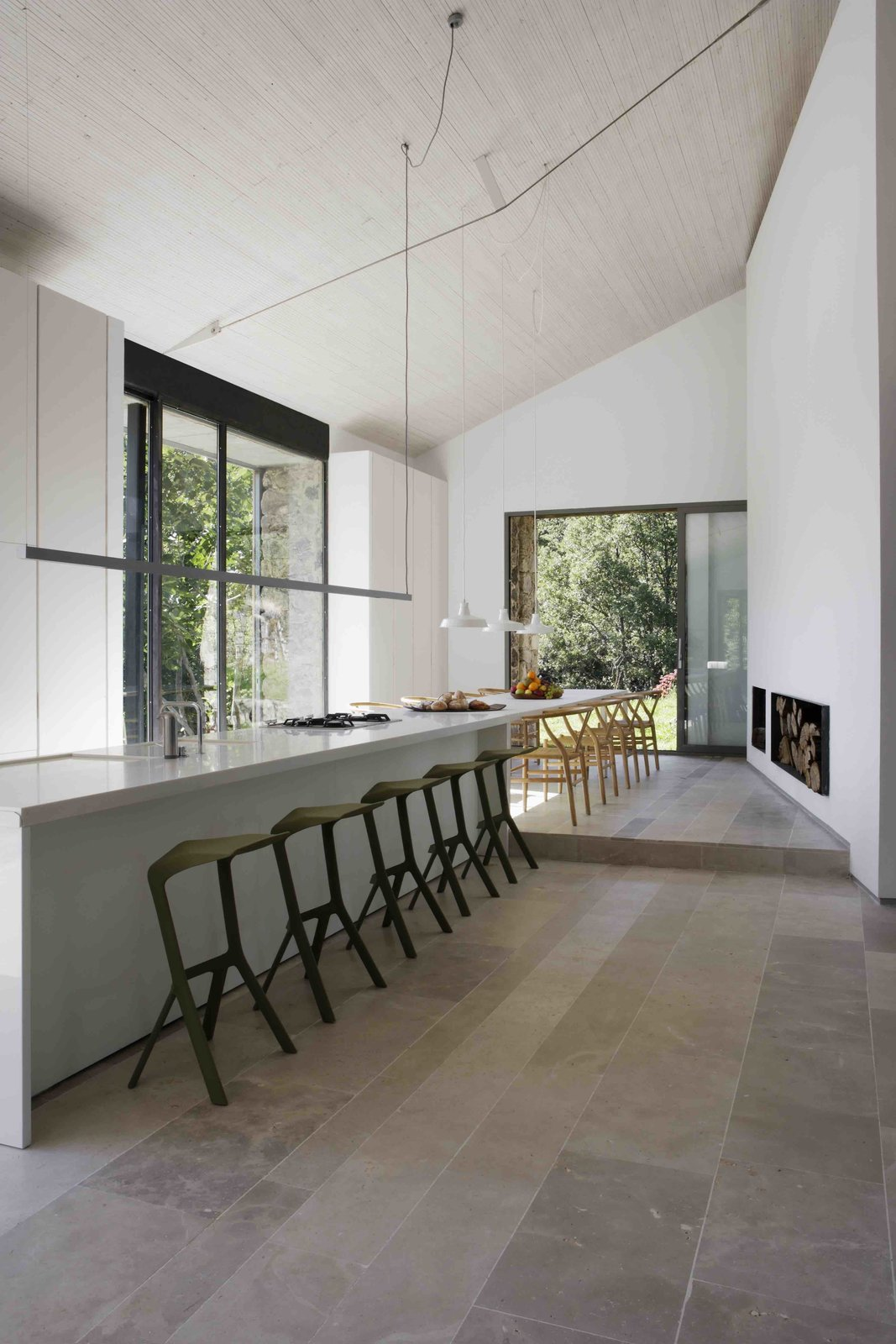 Kitchen, Porcelain Tile Floor, Drop In Sink, and Range  Photo 6 of 14 in An Abandoned Stable in Spain Is Transformed Into a Sustainable Vacation Home For Rent