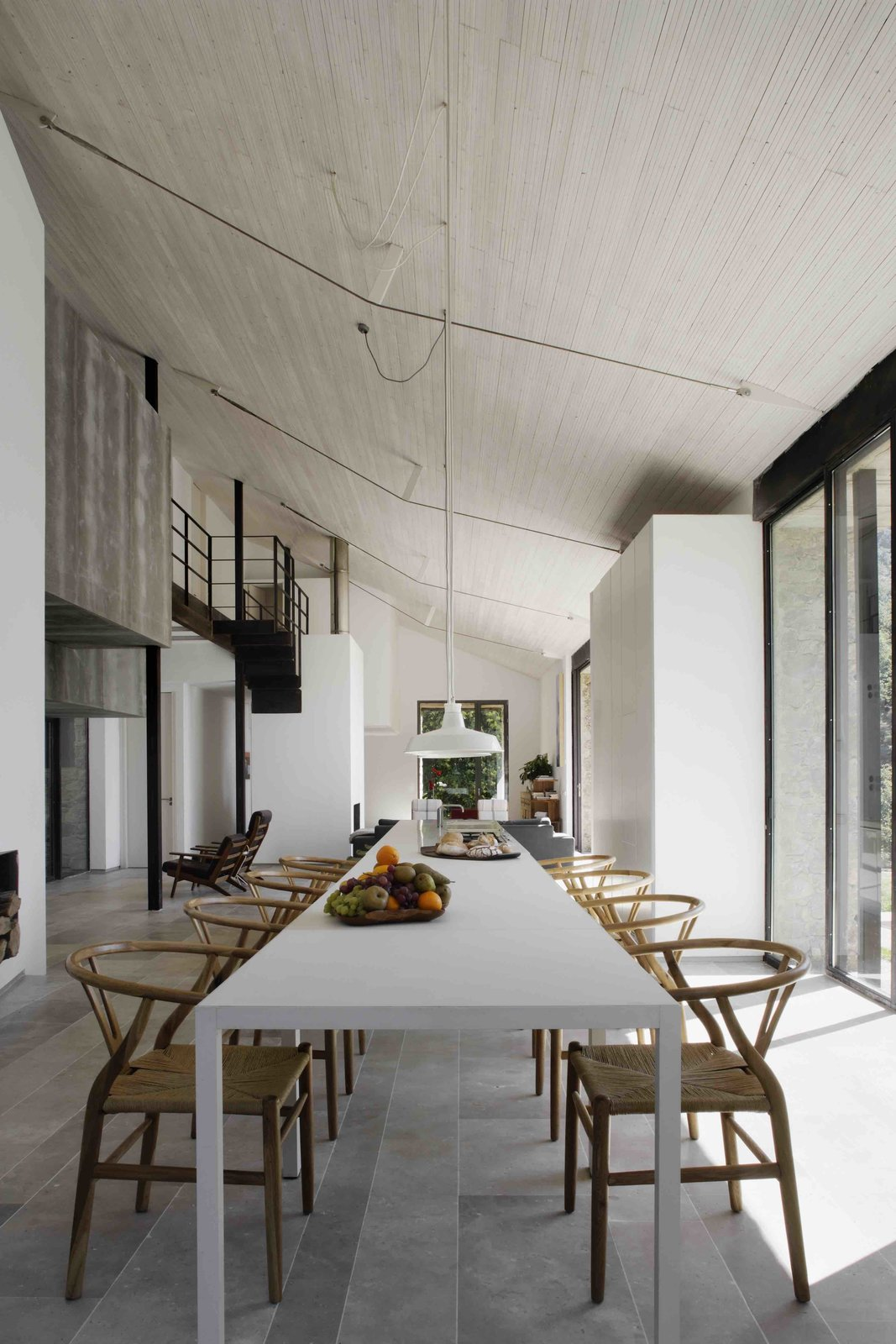 Dining Room, Chair, Table, and Pendant Lighting  Photo 7 of 14 in An Abandoned Stable in Spain Is Transformed Into a Sustainable Vacation Home For Rent