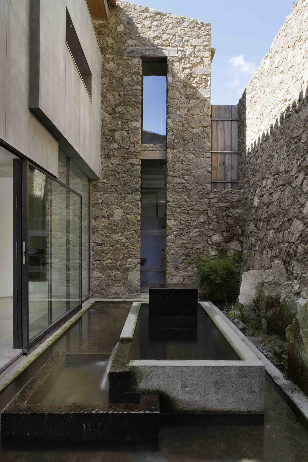 Outdoor, Hardscapes, and Side Yard  Photo 9 of 14 in An Abandoned Stable in Spain Is Transformed Into a Sustainable Vacation Home For Rent