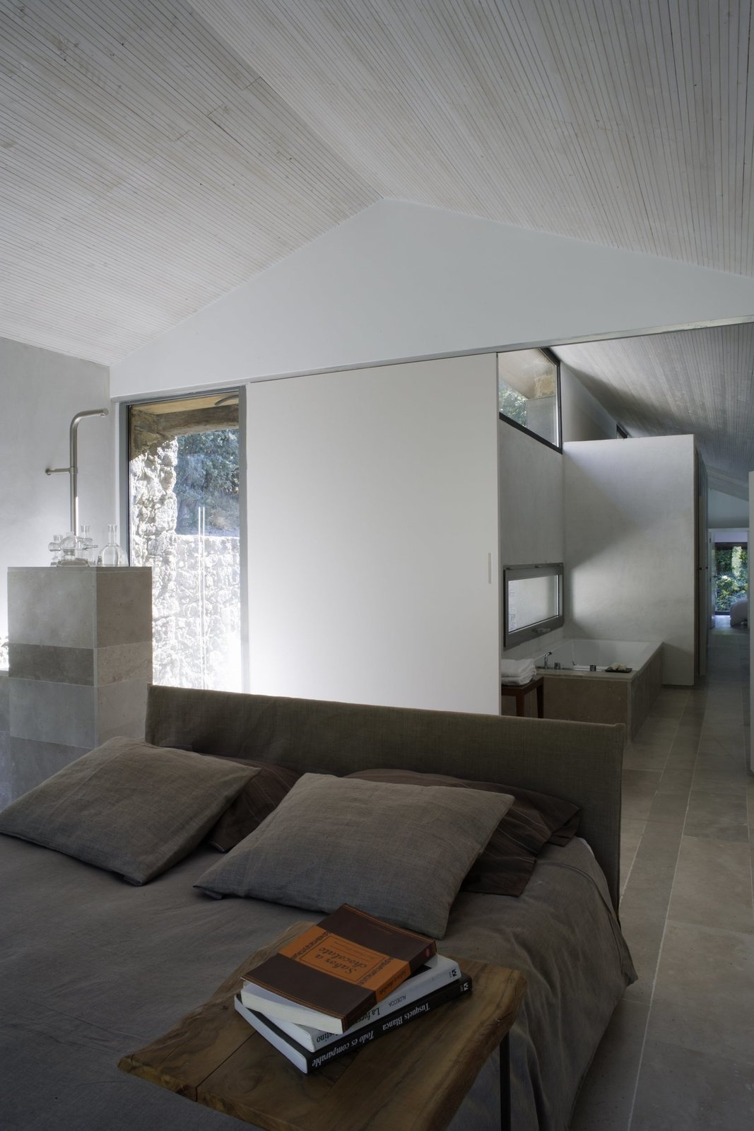 Bedroom and Bed  Photo 12 of 14 in An Abandoned Stable in Spain Is Transformed Into a Sustainable Vacation Home For Rent