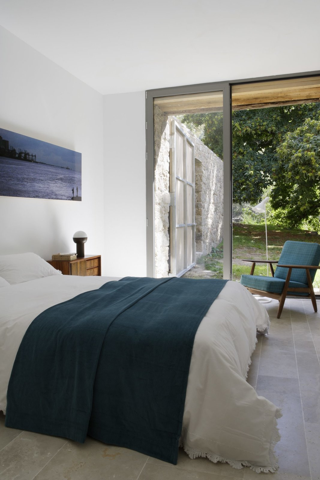 Bedroom, Bed, Chair, and Night Stands  Photo 13 of 14 in An Abandoned Stable in Spain Is Transformed Into a Sustainable Vacation Home For Rent
