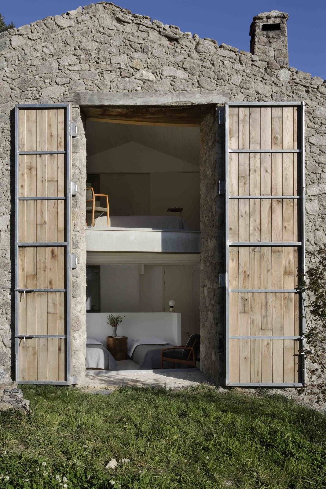 Exterior, Barn Building Type, Wood Siding Material, Stone Siding Material, Farmhouse Building Type, and House Building Type  Photos from An Abandoned Stable in Spain Is Transformed Into a Sustainable Vacation Home For Rent
