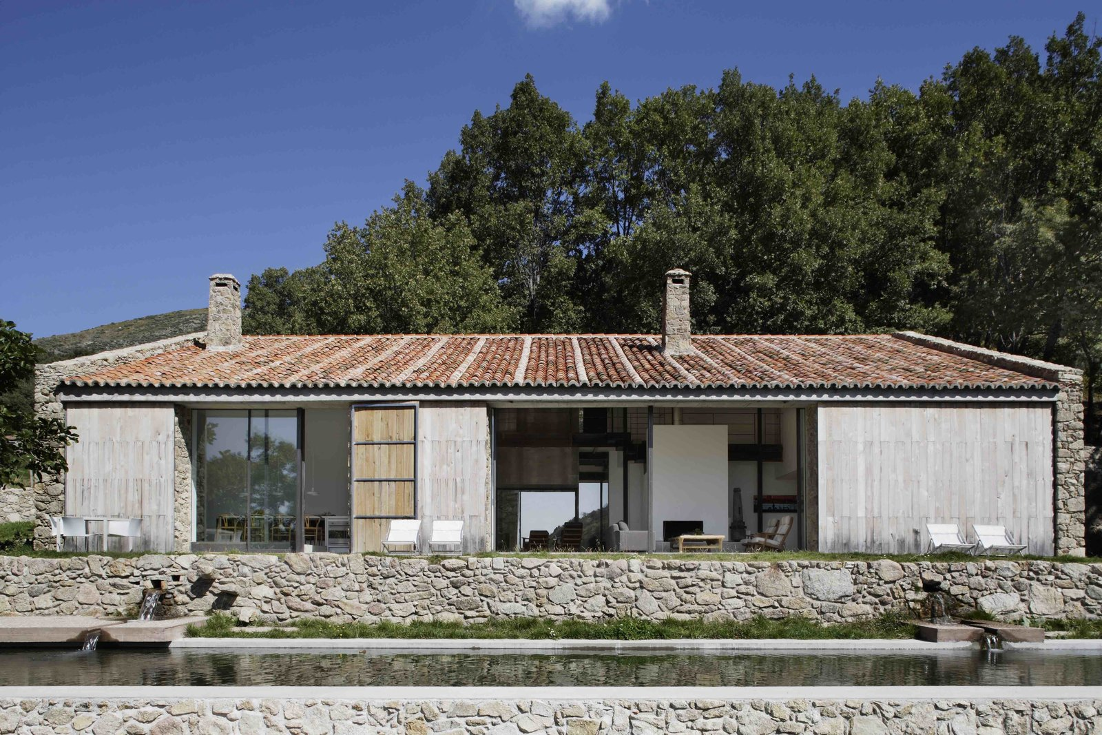 Exterior, Barn Building Type, Tile Roof Material, Wood Siding Material, Stone Siding Material, House Building Type, and Farmhouse Building Type  Photo 2 of 14 in An Abandoned Stable in Spain Is Transformed Into a Sustainable Vacation Home For Rent