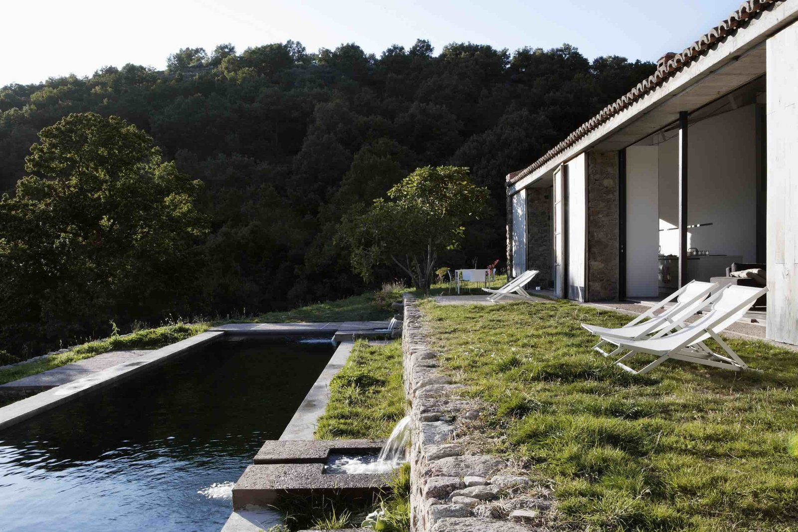 Outdoor, Back Yard, Boulders, Walkways, Trees, Grass, and Shrubs  Photo 11 of 14 in An Abandoned Stable in Spain Is Transformed Into a Sustainable Vacation Home For Rent