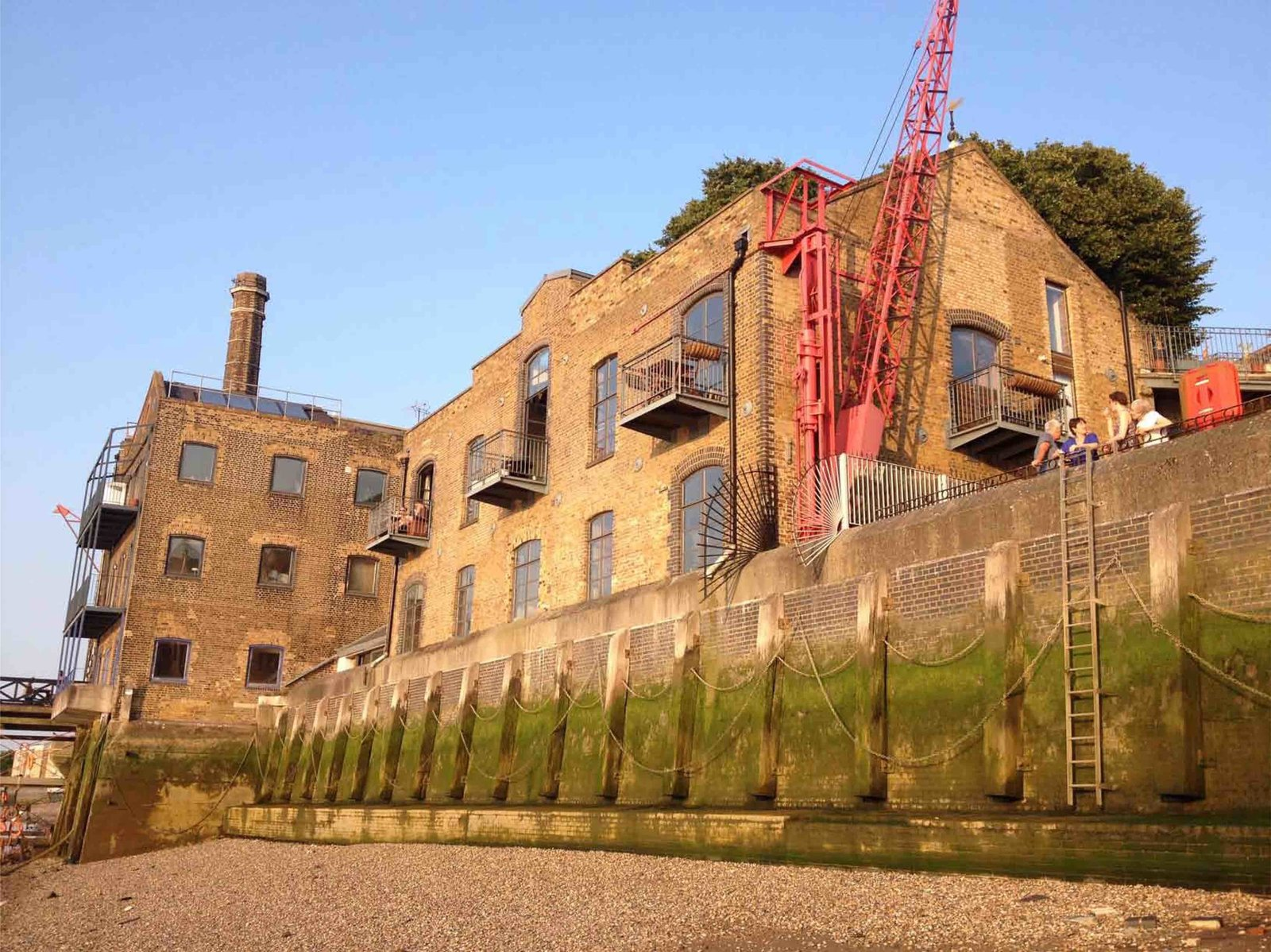 Exterior, Apartment Building Type, Gable RoofLine, and Brick Siding Material  Photo 2 of 12 in An Old Grain Warehouse on the River Thames Is Transformed Into an Industrial-Modern Home