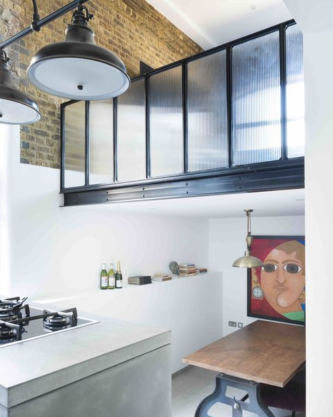 An Old Grain Warehouse on the River Thames Is Transformed Into an Industrial-Modern Home - Photo 4 of 11 -