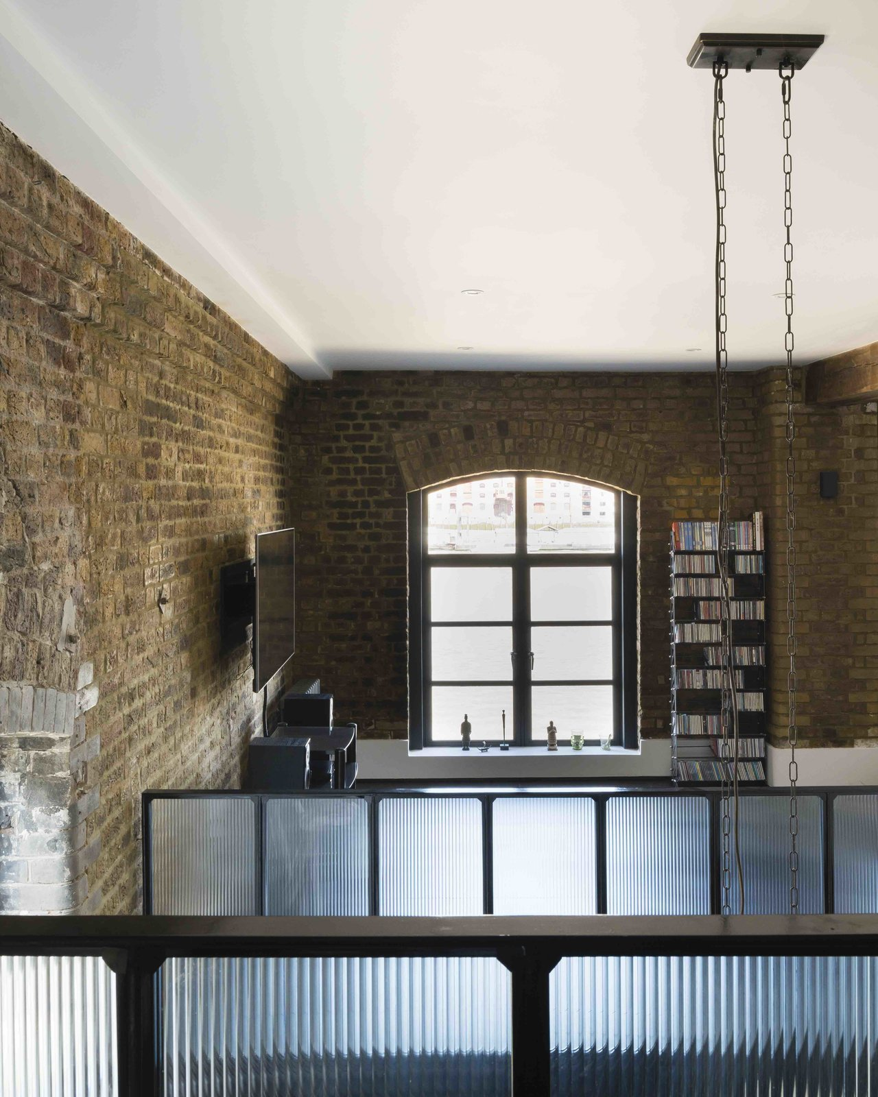 Living Room and Bookcase  Photo 4 of 12 in An Old Grain Warehouse on the River Thames Is Transformed Into an Industrial-Modern Home
