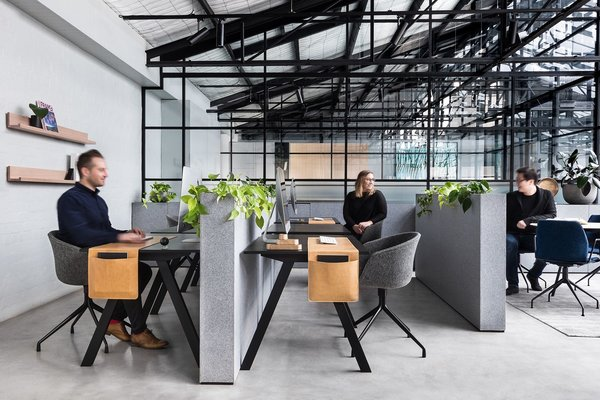 Though the steel trusses and brick walls of the original warehouse were retained, the architects installed a transparent roof to flood the interiors with sunlight.
