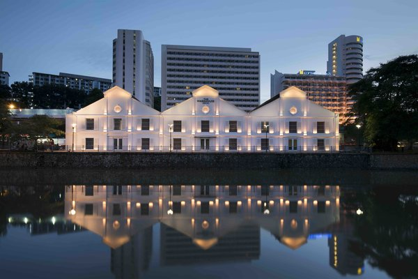Designed by Asylum and Zarch Collaborative, this converted warehouse along the Singapore River boasts a lobby with vaulted ceilings that puts a spotlight on the original pulley systems that were commonly found in godowns (shown in the cover photo above).