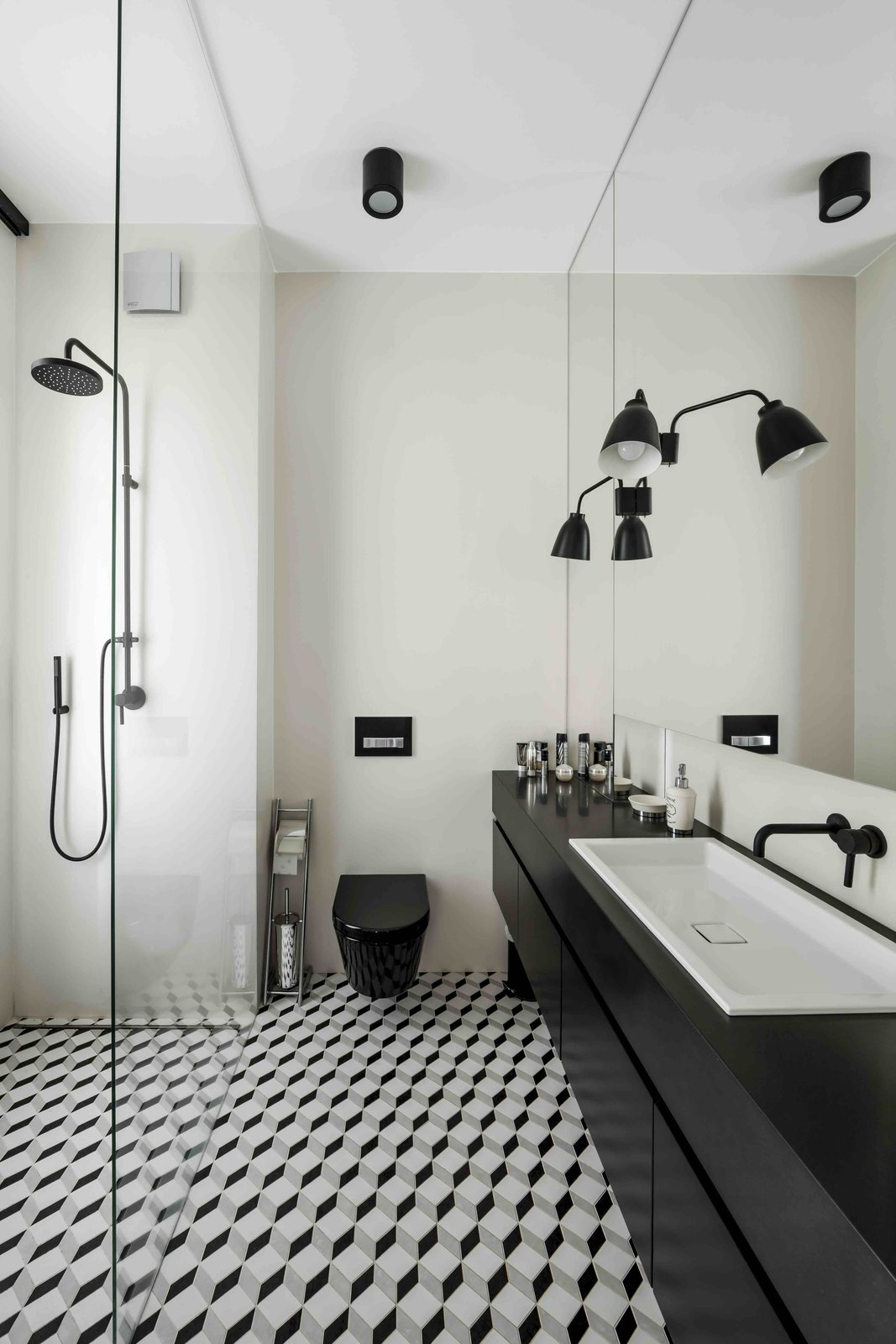 Bath Room, Open Shower, Wall Lighting, Ceiling Lighting, and One Piece Toilet  Photo 6 of 12 in Filled With Color and Pattern, This Eclectic Apartment Brings a Little Madrid to Warsaw