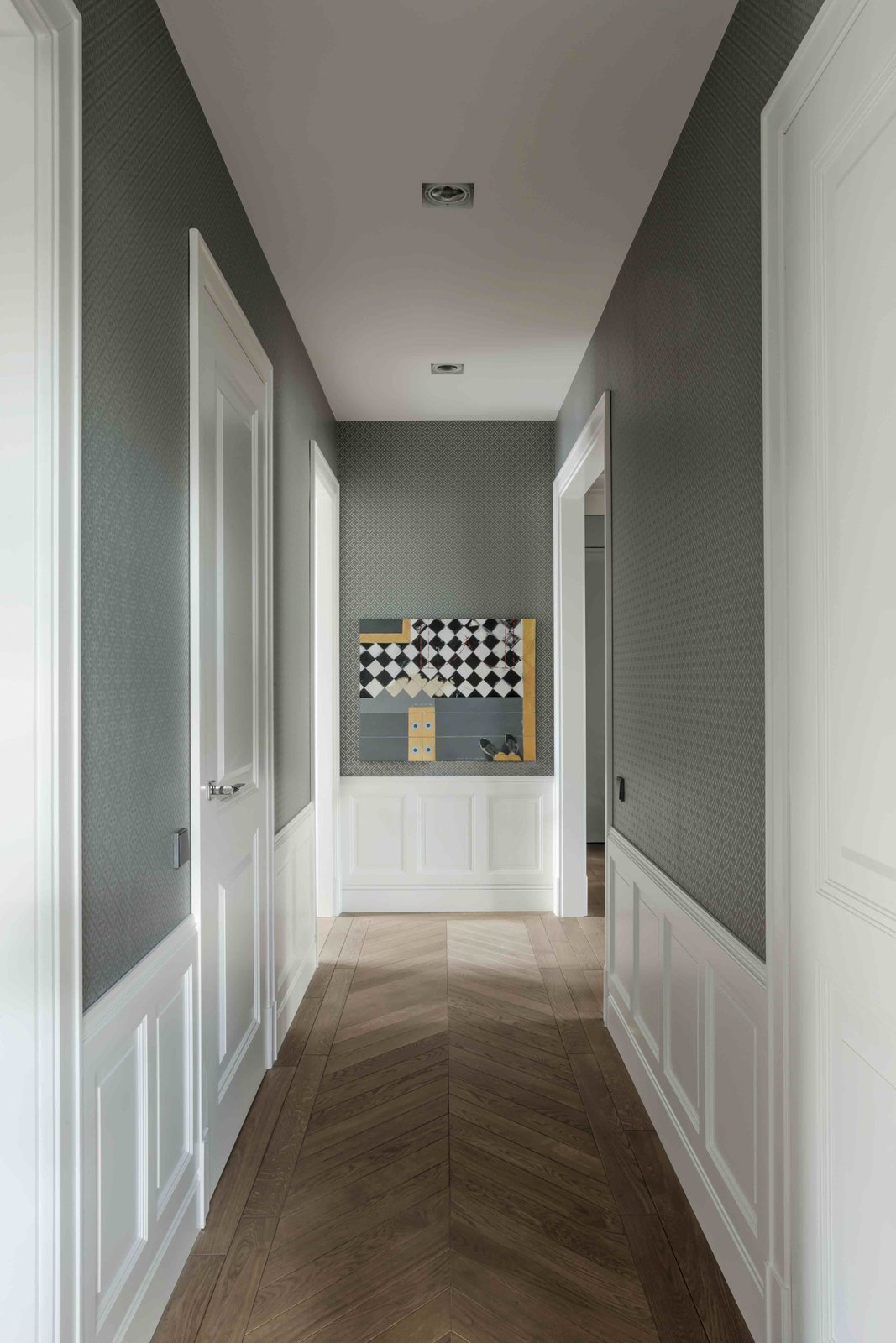 Hallway and Medium Hardwood Floor  Photo 8 of 12 in Filled With Color and Pattern, This Eclectic Apartment Brings a Little Madrid to Warsaw
