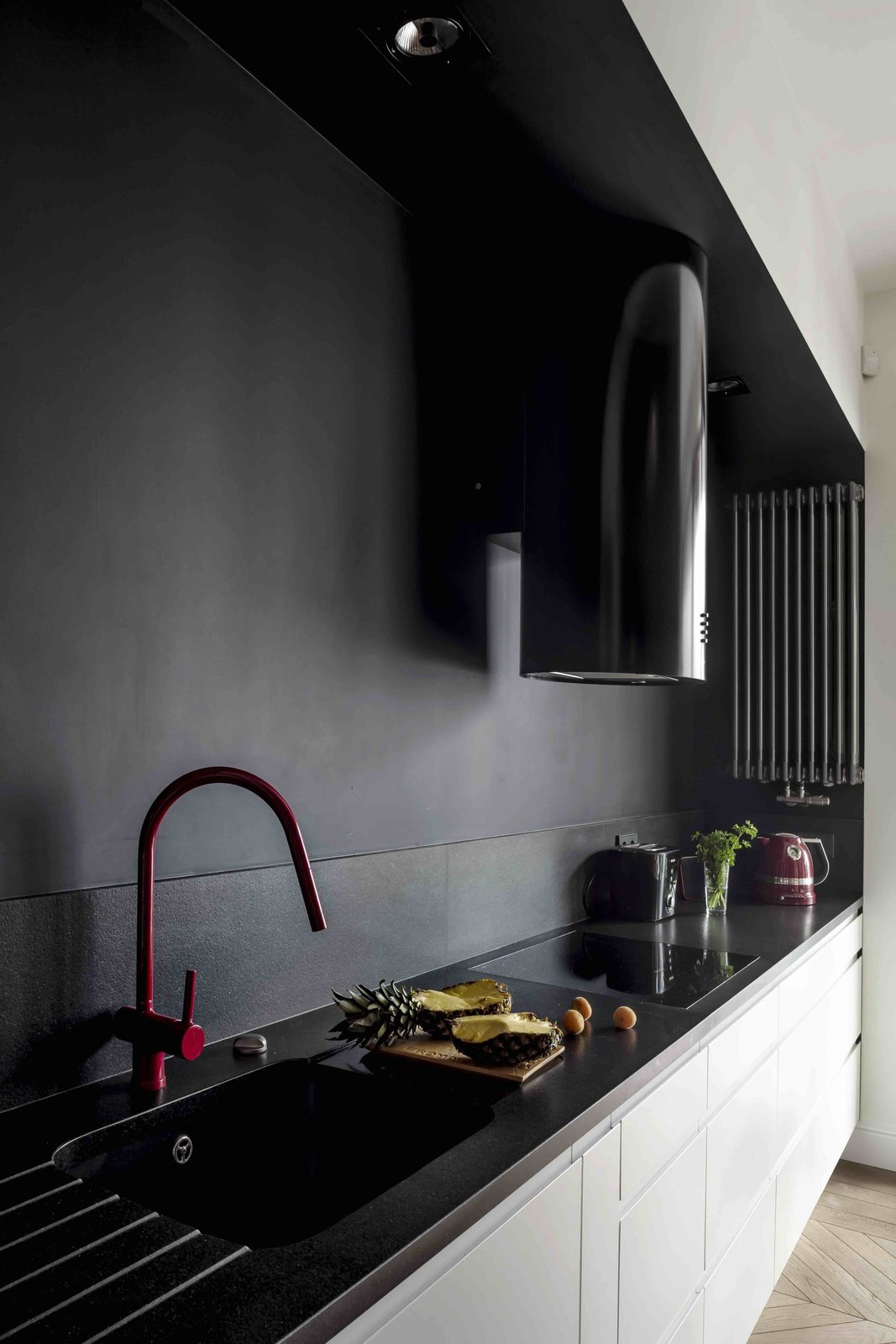 Kitchen, White Cabinet, Light Hardwood Floor, Recessed Lighting, Drop In Sink, Range, and Range Hood  Photo 9 of 12 in Filled With Color and Pattern, This Eclectic Apartment Brings a Little Madrid to Warsaw