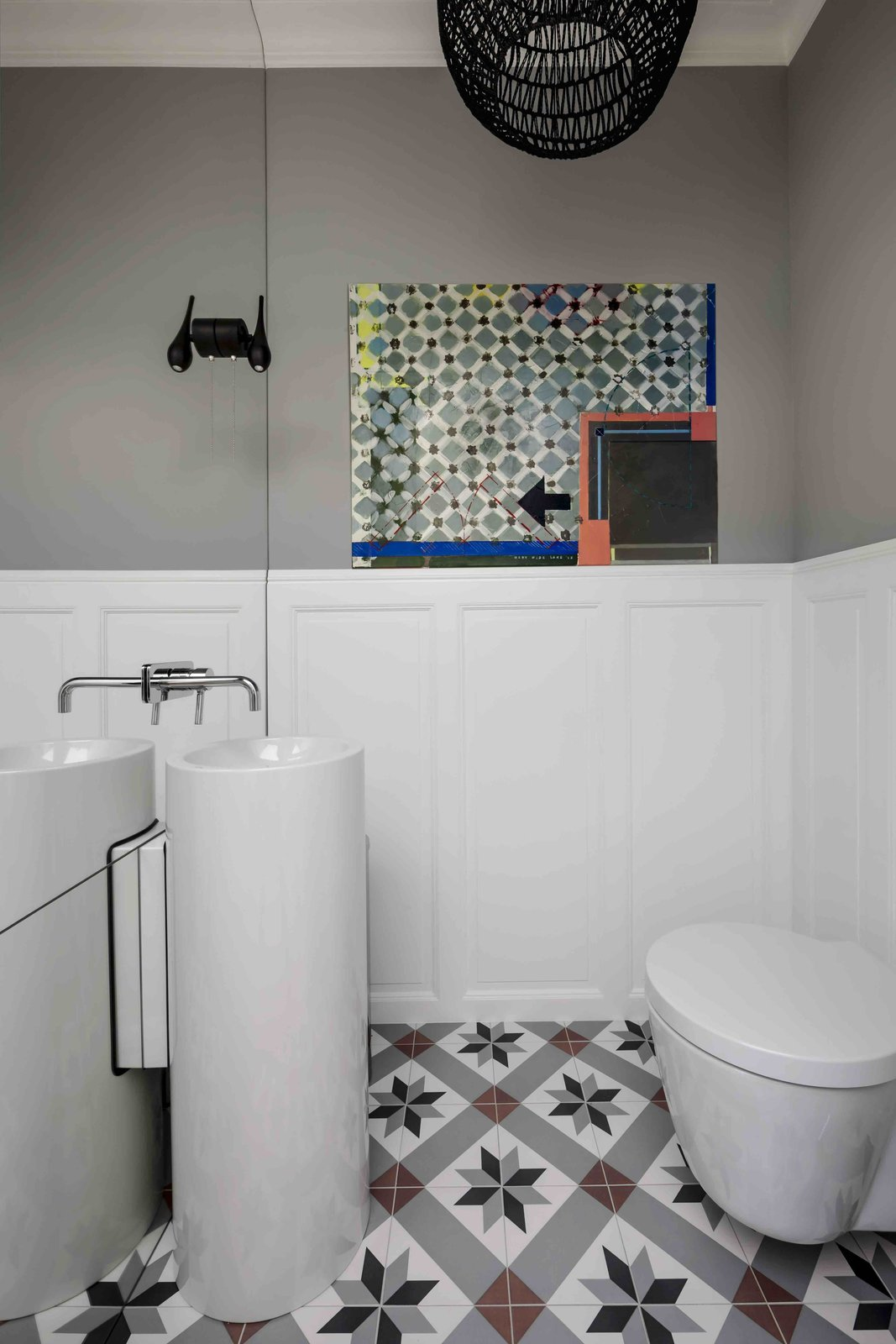 Bath Room, One Piece Toilet, Wall Lighting, and Pedestal Sink  Photo 10 of 12 in Filled With Color and Pattern, This Eclectic Apartment Brings a Little Madrid to Warsaw