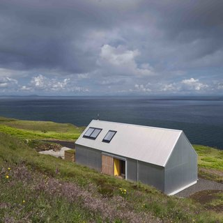 "Though not made of stone or brick like the other homes in this roundup, this two-person escape designed by Rural Design Architects on Scotland's Isle of Skye was made with corrugated metal, a material that's commonly used for agricultural sheds or ""crofters cottages"" in the rural areas of Scotland."
