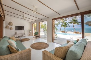 Originally a traditional fishing house right by the beach, this three-bedroom vacation home was renovated with a touch of beach leisure, and includes sumptuous sofas that look out to the pool and sea, as well as an outdoor sala that's great for morning yoga and meditation.