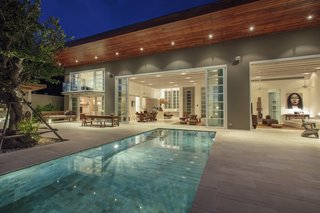 6 Modern Pool Villas to Stay at While Visiting Koh Samui, Thailand - Photo 6 of 6 - This contemporary villa has three en suite bedrooms, a sandstone sun terrace, and an infinity-edge pool with an outdoor mirror feature that captures reflections of the modern Asian interiors.