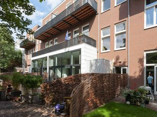 An Old Amsterdam School Is Converted Into 10 Apartments - Photo 2 of 15 -