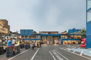 Discover 5 Public Buildings in South Korea Made Out of Shipping Containers - Photo 1 of 10 - Common Ground is a dynamic mall in Seoul that's made out of 200 blue stacked prefabricated container modules. The 57,048-square-foot building, which took only five months to construct, is home to a variety of retail stores and food-and-beverage outlets that frequently draw a lively crowd.
