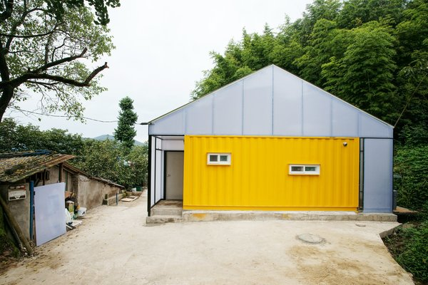 With sponsorship from the Korea Child Fund, Seoul practice JYA-Architects designed this low-cost home in the small county of Jangheung in the southeastern province of South Korea. It was created to help improve the quality of life of a low-income family of seven. Using just three shipping containers and light-gauge, translucent framing, this home is a great example of how sustainable design can be used to address a tight budget.