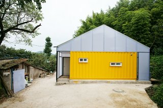 Discover 5 Public Buildings in South Korea Made Out of Shipping Containers - Photo 3 of 10 - With sponsorship from the Korea Child Fund, Seoul practice JYA-Architects designed this low-cost home in the small county of Jangheung in the southeastern province of South Korea. It was created to help improve the quality of life of a low-income family of seven. Using just three shipping containers and light-gauge, translucent framing, this home is a great example of how sustainable design can be used to address a tight budget.