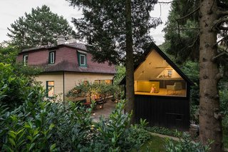 This 1930s black timber shed near the town of Eichgraben in Austria was converted by Vienna practice Franz & Sue into a writing studio, playhouse, and guest room. It's accessed through a trapdoor, with a fully glazed gable that looks out to the treetops.