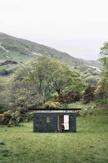 With a facade made of recycled slate tiles that were reclaimed from nearby farms, this writer's retreat on the edge of Snowdonia National Park in Mid Wales offers not only plenty of solitude, but also natural inspiration, thanks to the lush green valleys and windswept hills of the Welsh countryside. It was designed by Sydney-based architecture firm TRIAS.