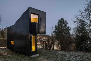 Another writer's studio designed by Jarmund/Vigsnæs AS Arkitekter MNAL, this 161-square-foot cottage in the garden of an Oslo suburban home functions as a writing space for its owners. It features full glazing on its north facade in order to draw in ample natural light.