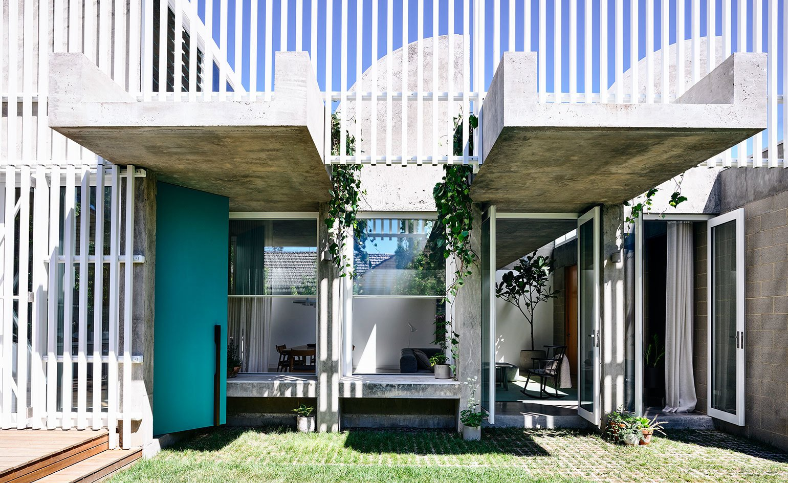 Exterior, Concrete Siding Material, and House Building Type  Photo 1 of 11 in Vaulted Skylights and Concrete Columns Connect This Melbourne Home With the Sun