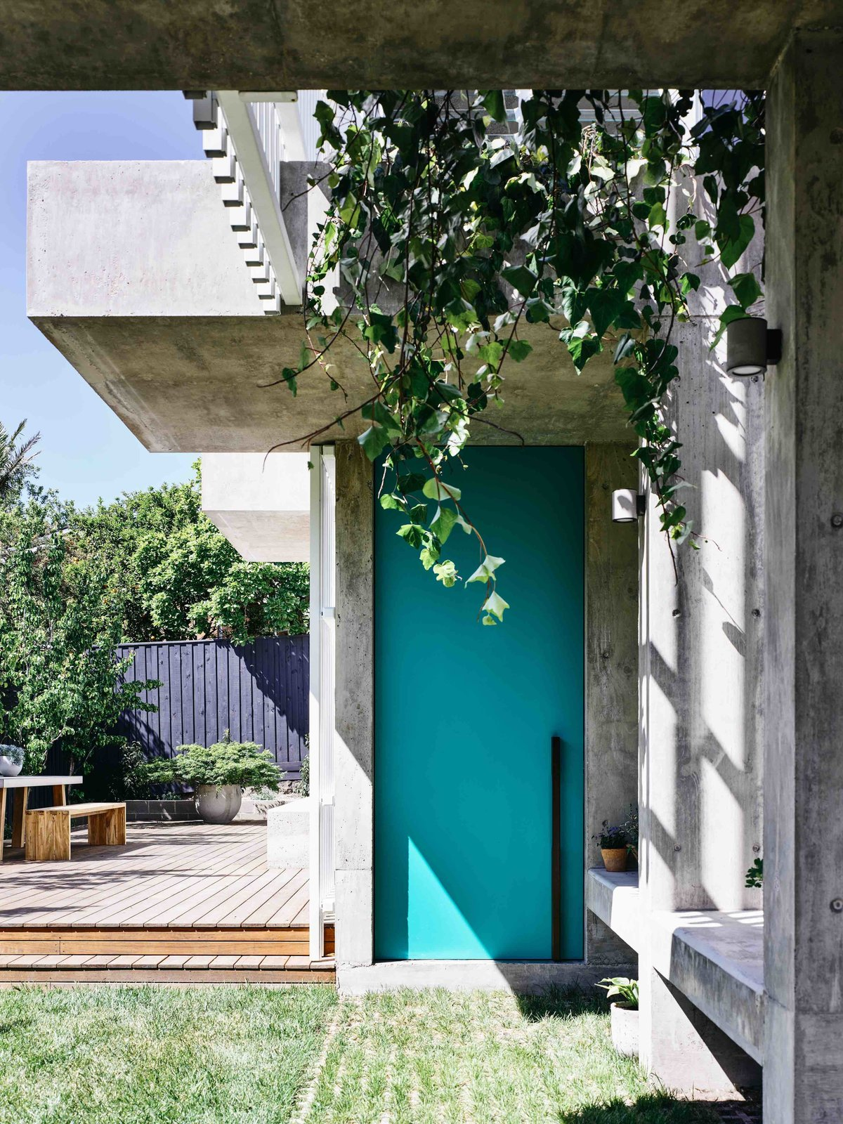 Doors and Exterior  Photo 7 of 11 in Vaulted Skylights and Concrete Columns Connect This Melbourne Home With the Sun
