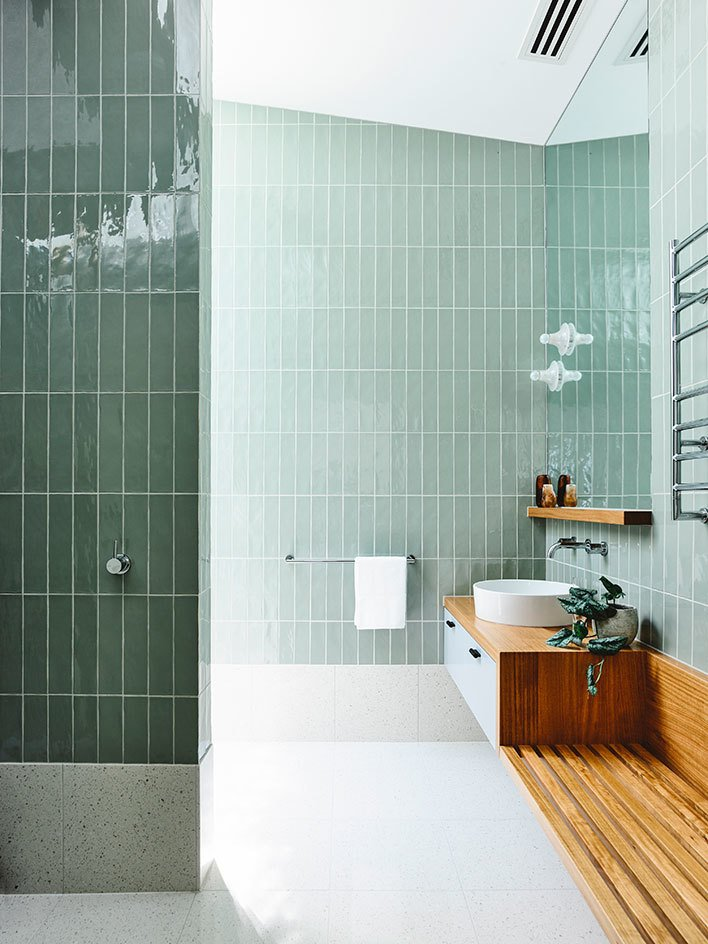 Bath Room, Vessel Sink, Open Shower, Wall Lighting, and Ceramic Tile Wall  Photos from Vaulted Skylights and Concrete Columns Connect This Melbourne Home With the Sun