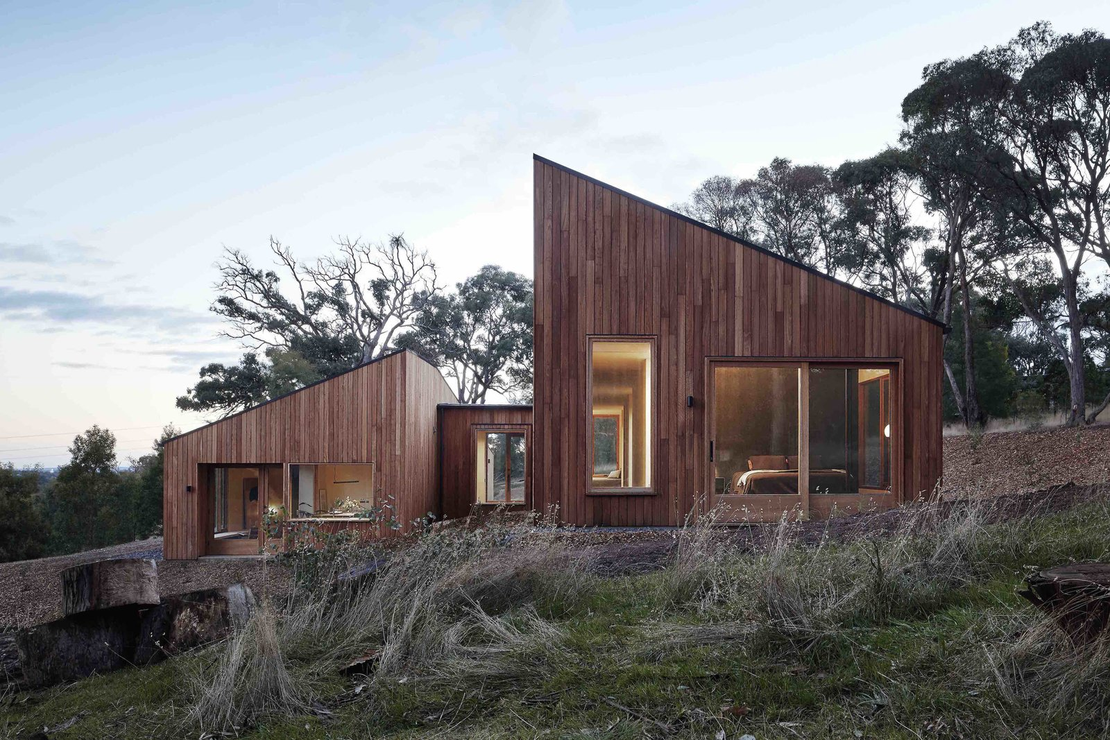 Exterior, House Building Type, Wood Siding Material, and Shed RoofLine  Photos from A Bushland Home in Melbourne That's Divided Between Two Pavilions