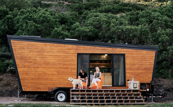 """Nicknamed """"Woody,"""" this 236-square-foot trailer has taken a young, upwardly-mobile couple from Austin, Texas, to the Rocky Mountains hamlet of Marble, Colorado. Built at a cost of just around $50,000, the trailer was fitted with modern birch-veneer plywood and skylights, and has a half-size refrigerator, eight-inch-deep storage compartments built into the floor, a loft bed, and even a galvanized-steel cow trough bathtub."""