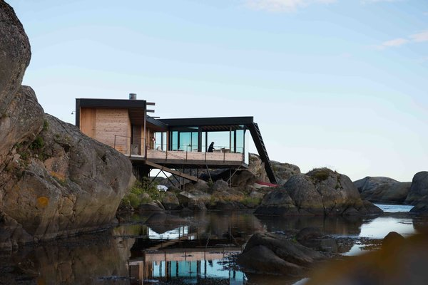 A Norwegian Summer Cabin Embraces the Rocky Terrain