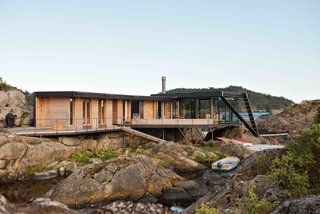 A Norwegian Summer Cabin Embraces the Rocky Terrain - Photo 2 of 10 -