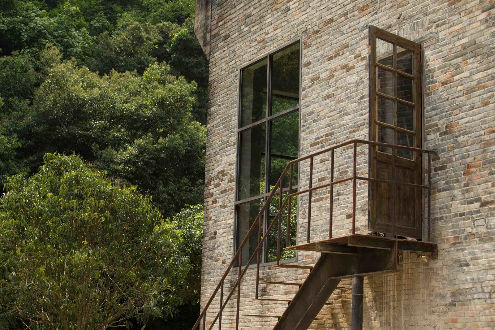 Staircase, Metal Tread, and Metal Railing  Alila Yangshuo from A Chinese Sugar Mill From the 1960s Becomes a Cave-Inspired Hotel