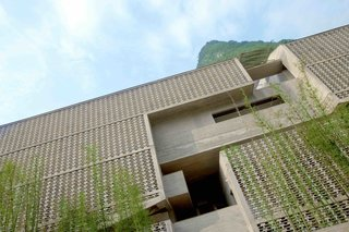 A Chinese Sugar Mill From the 1960s Becomes a Cave-Inspired Hotel - Photo 6 of 17 -