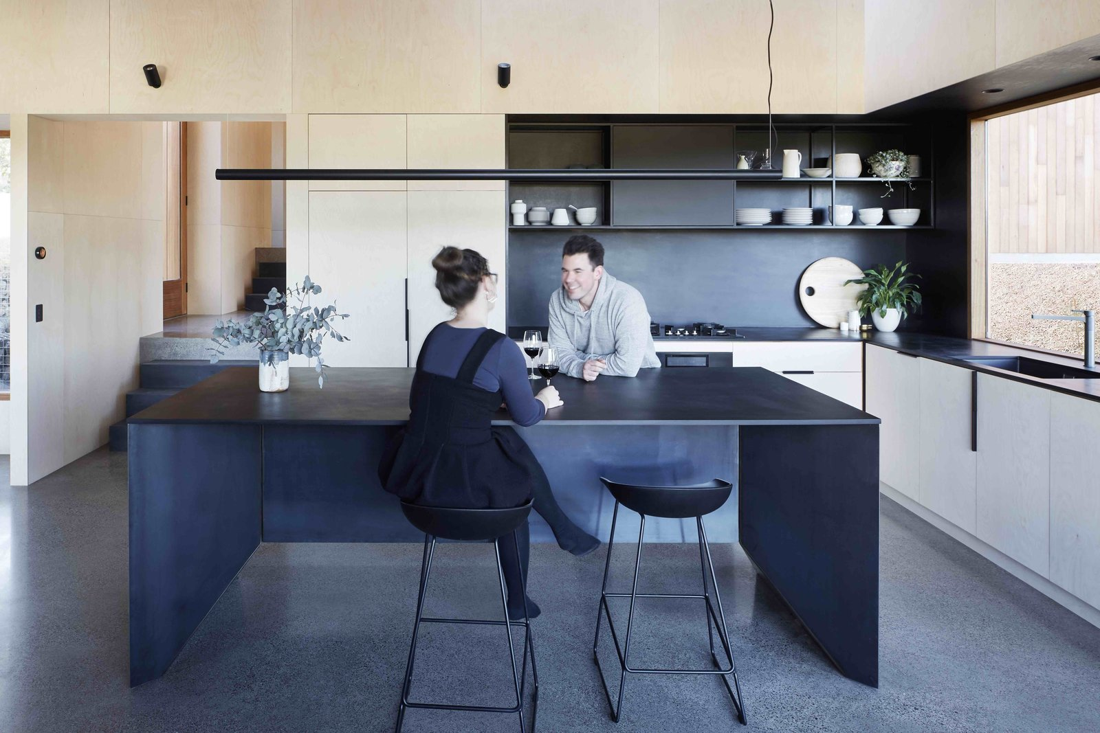 Kitchen, Open, Pendant, Wall, Range, Undermount, Concrete, Wall Oven, and Wood  Best Kitchen Concrete Wood Wall Photos from A Bushland Home in Melbourne That's Divided Between Two Pavilions