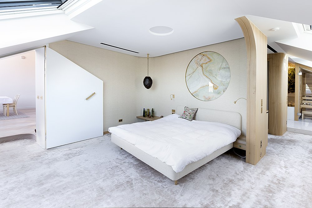 Bedroom, Bed, Night Stands, Pendant Lighting, and Wall Lighting  Photo 7 of 18 in A Dreamy Loft in Prague With Castle Views and an Onyx Moon